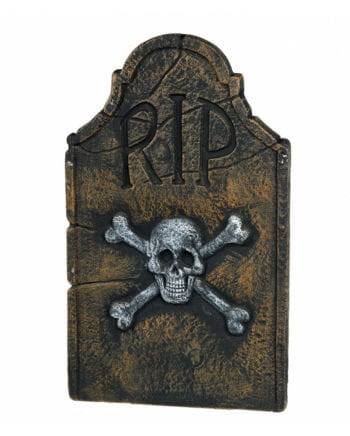 Grave stone with skull