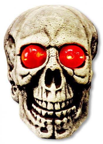 Riesen Totenkopf mit rot leuchtenden Augen