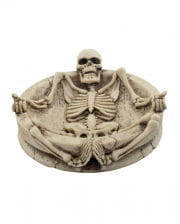 Ashtray with lying skeleton