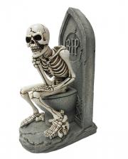 Thinking Skeleton Figure On Toilet