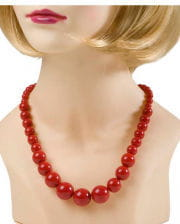 Red plastic pearl necklace