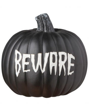 "Black pumpkin with the words ""Beware"""