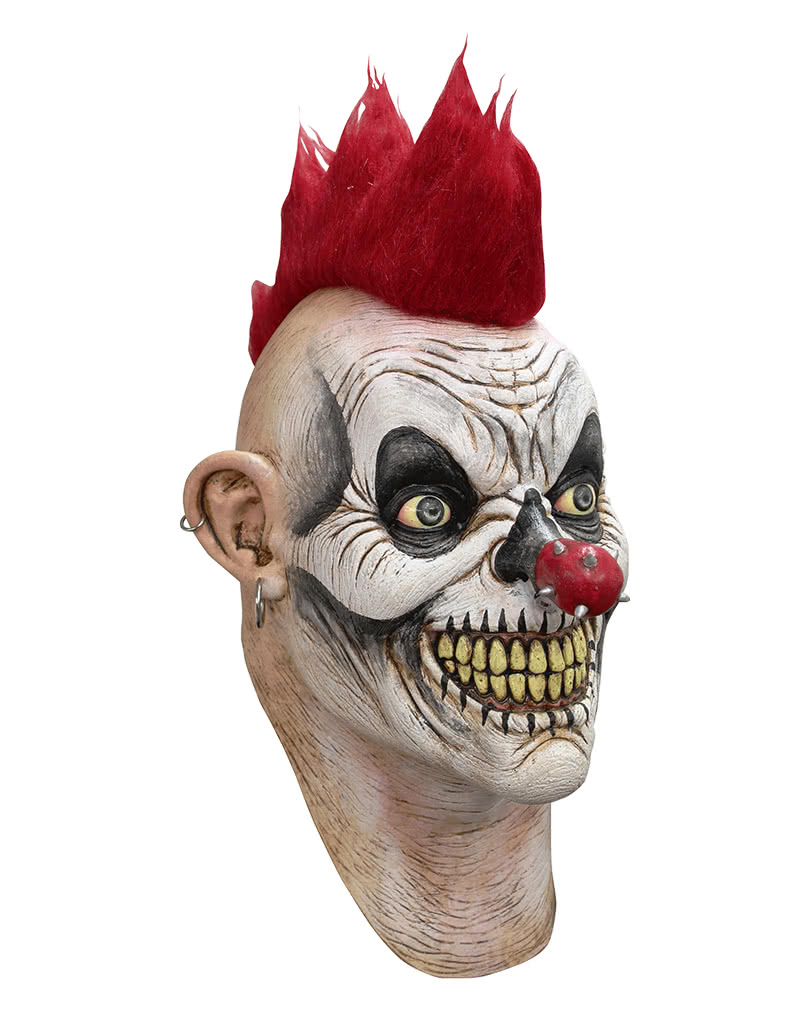 clown punk Simple summary a man driving home through the rundown (shonky) side of town with his children in the backseat sees a heavily tattooed homeless man.